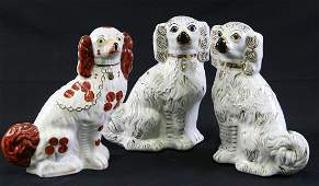 THREE ANTIQUE STAFFORDSHIRE PORCELAIN DOG FIGURES