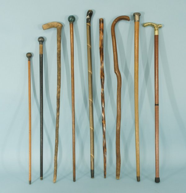 9: GROUP OF NINE WOODEN CANES WITH METAL TIPS