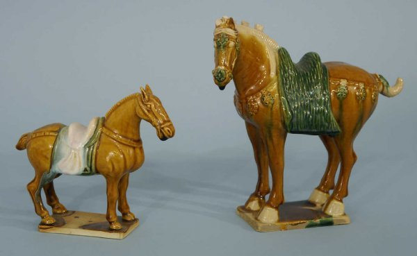 3: TWO BROWN AND GREEN MAJOLICA HORSE STATUETTES