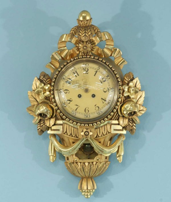 198: ANTIQUE WOOD CARVED AND GILDED WALL CLOCK