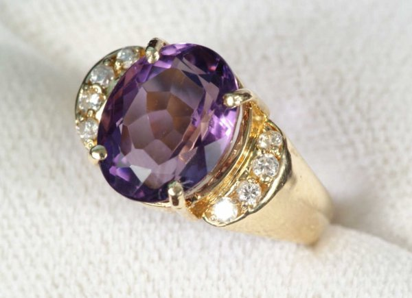 2C: 6.00 CT. OVAL AMETHYST AND .40 CT. DIAMOND RING