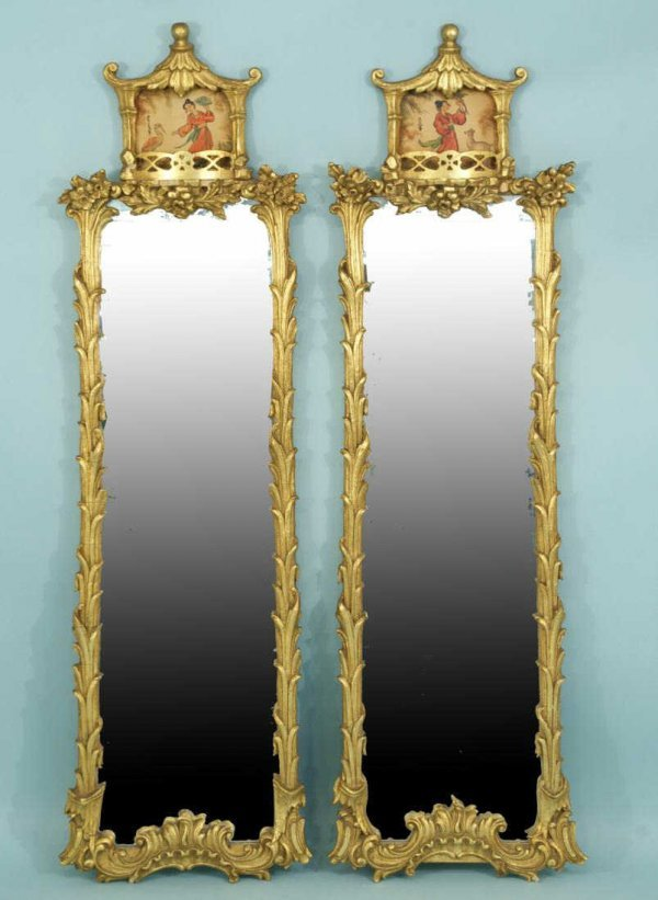 9: PAIR OF ORIENTAL STYLE CARVED AND GILDED MIRRORS