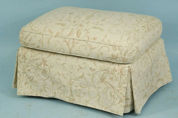 13: OTTOMAN UPHOLSTERED IN IVORY DAMASK