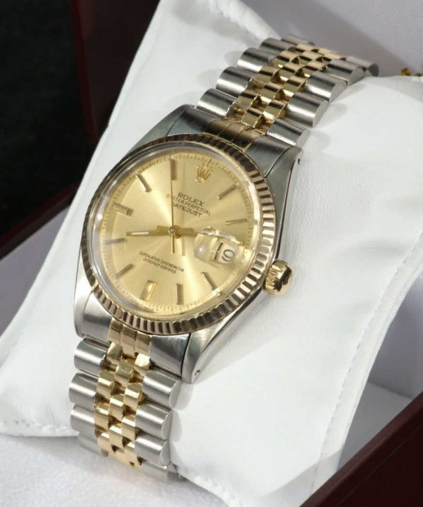 15A: ROLEX GENTLEMANS STERLING SILVER AND 14KT. GOLD WA