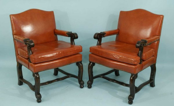 21: SET OF TEN ARMCHAIRS IN RUST COLORED LEATHER