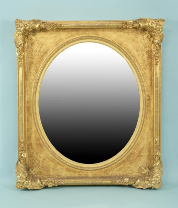 8: ANTIQUE FRENCH WOOD CARVED AND GILDED OVAL MIRROR