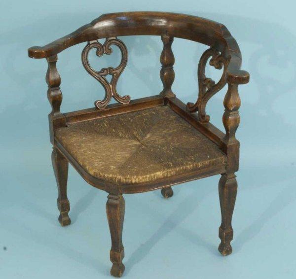 10: ENGLISH MAHOGANY CORNER CHAIR, CIRCA 1850's