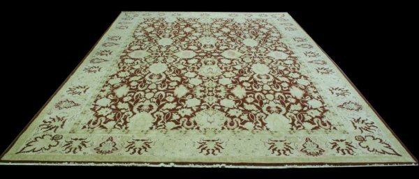 19: HAND KNOTTED RUG IN MAROON AND CAMEL