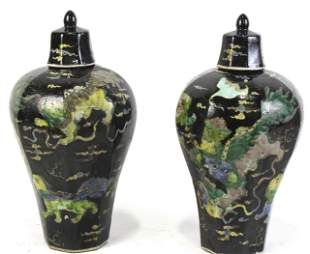 PAIR OF CHINESE FAMILLE NOIRE LIDDED JARS