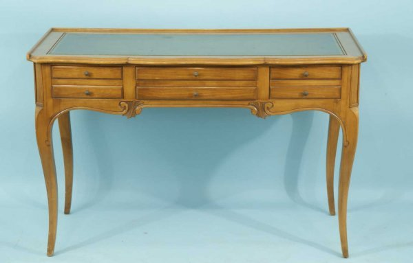 18: CARVED WALNUT DESK WITH TOOLED LEATHER TOP
