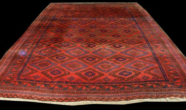 8: LARGE PERSIAN HERIZ RUG, NAVY IN A RED BACKROUND.