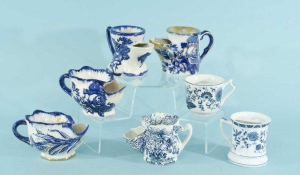 18: SEVEN ANTIQUE BLUE & WHITE PORCELAIN MUSTACHE CUPS