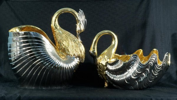 6: TWO CERAMIC GOLD AND SILVERPLATE SWAN FIGURES