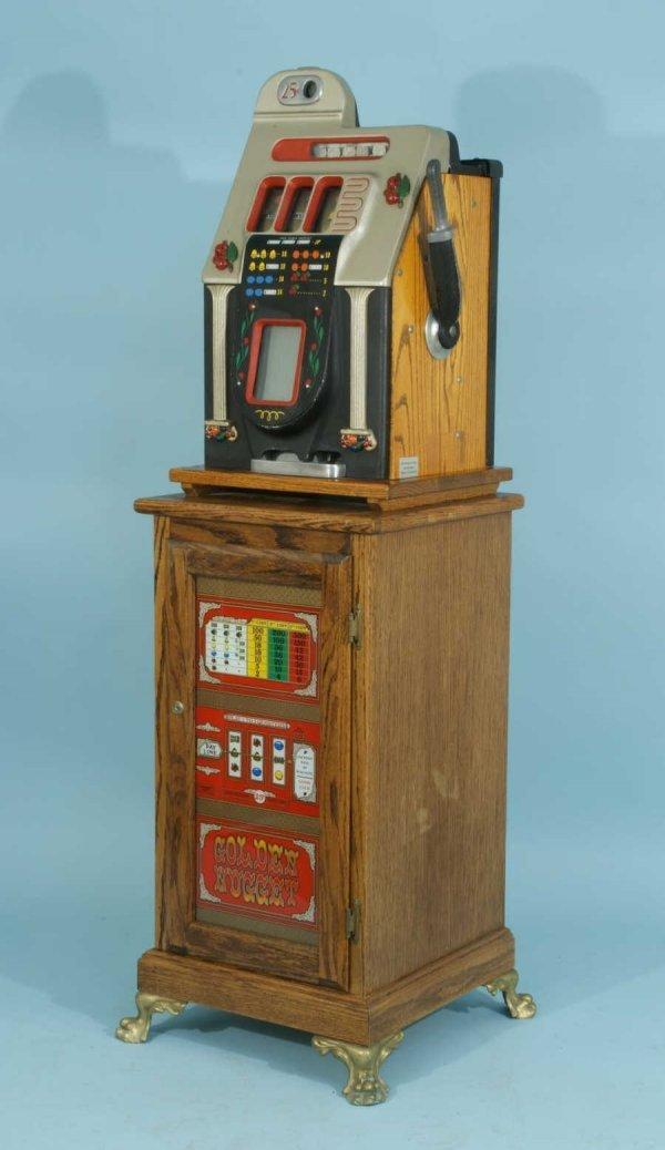 84: VINTAGE TWENTY-FIVE CENT SLOT MACHINE BY MILLS
