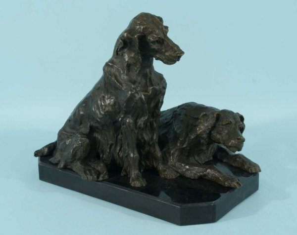 15: TWO BRONZE SEATED DOGS ON MARBLE PLINTH