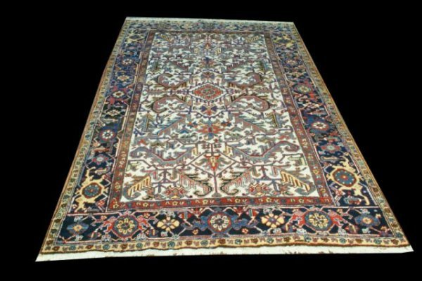 13: IVORY HERIZ RUG, CIRCA 2nd QUARTER 20th CENTURY