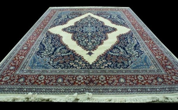 1B: LARGE PERSIAN RUG WITH FLORAL MEDALLION