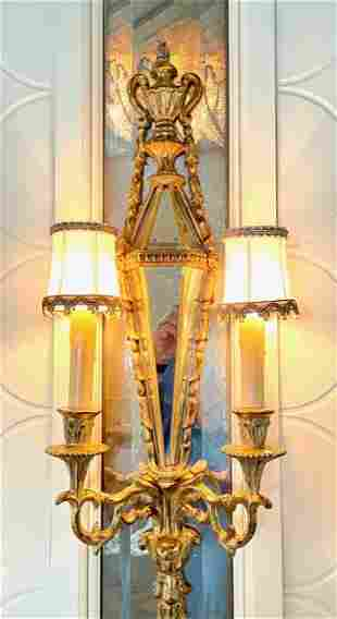 SET OF FOUR CARVED & GILDED TWO LIGHT SCONCES