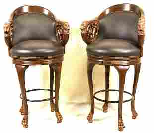 PAIR OF CARVED & GILDED LEATHER BARSTOOLS