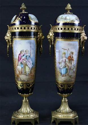 PAIR OF 19th CENTURY SEVRES LIDDED URNS