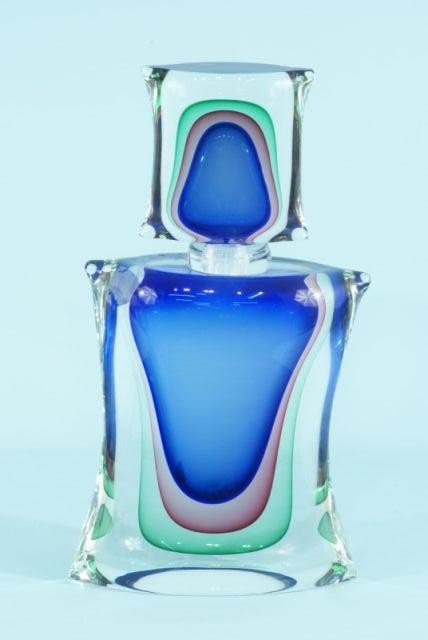 47: GLASS SCULPTURE IN THE SHAPE OF A PERFUME BOTTLE