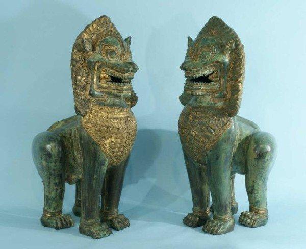 55: PAIR OF THAI BRONZE FOO DOG STATUES