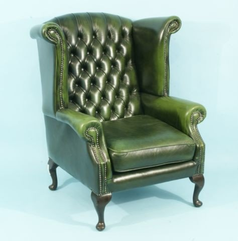 220: BUTTON-TUFTED GREEN LEATHER WING CHAIR