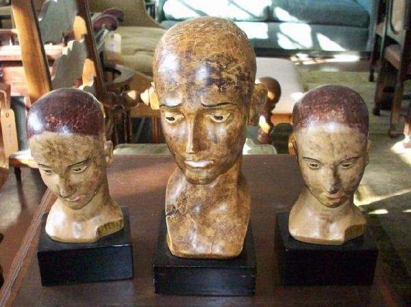 117: THREE WOOD CARVED HUMAN BUSTS