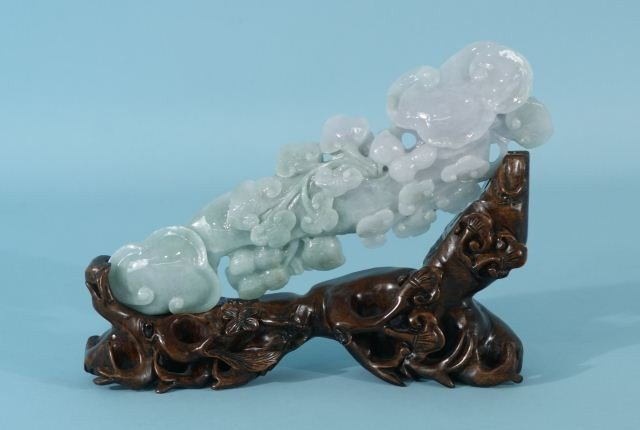 23: CHINESE CARVED GREEN & WHITE JADE OF FLOWERS