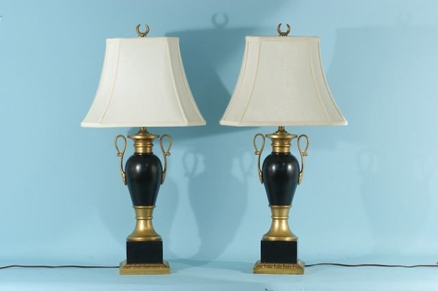 11: PAIR OF URN SHAPED BLACK AND GOLD LAMPS