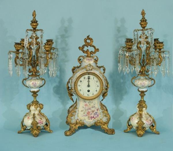 16: THREE-PIECE FRENCH PORCELAIN CLOCK SET, CIRCA 1875