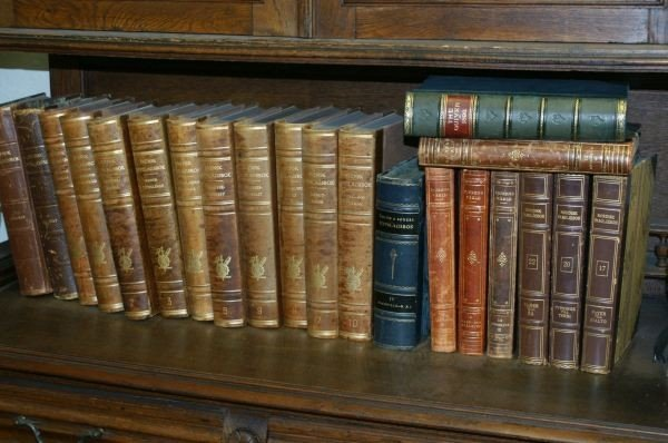 54: Set of approximately 21 leather bound books