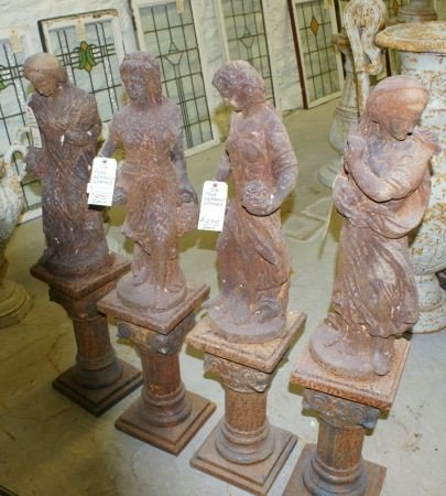 780: Set of 4 Cast Iron Female Figures on Pedestals Rep