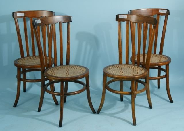 16: FOUR CANE SEAT SIDE CHAIRS WITH SPINDEL BACKS