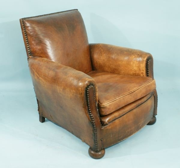 52: DISTRESSED TAN LEATHER FRENCH CLUB CHAIR c. 1930