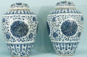 TWO CHINESE BLUE & WHITE PORCELAIN LIDDED URNS