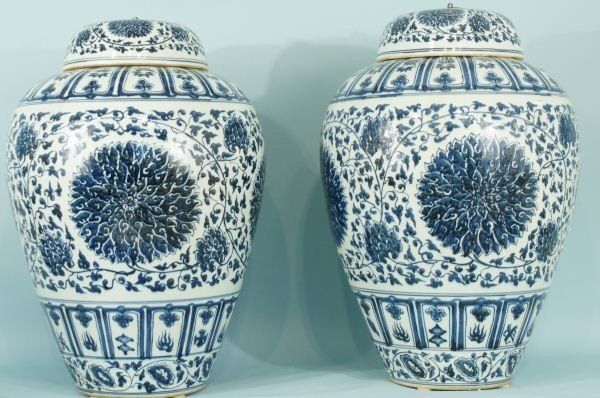 48: TWO CHINESE BLUE & WHITE PORCELAIN LIDDED URNS