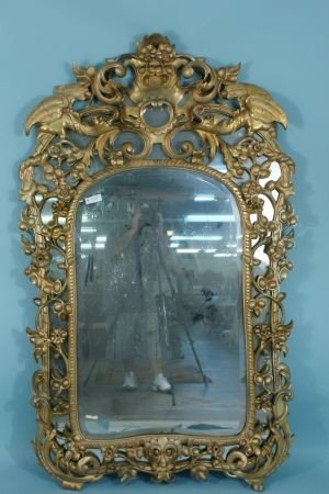 51: ANTIQUE WELL CARVED & GILDED BEVELED GLASS MIRROR