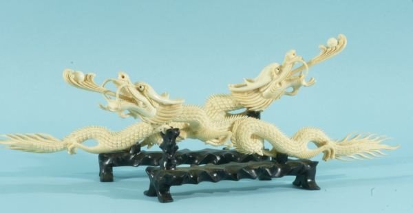 19: TWO CARVED IVORY DRAGONS ON STANDS