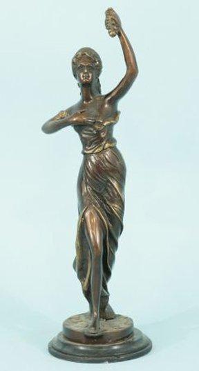 18: BRONZE PATINA LADY HOLDING GRAPES SCULPTURE
