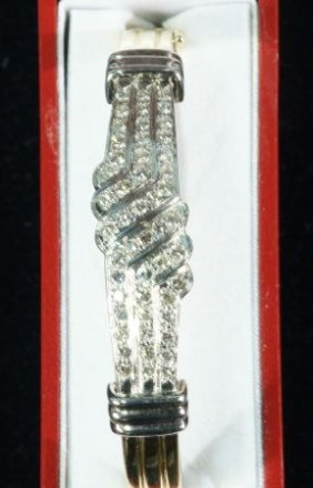 14 KT. YELLOW-GOLD HINGED DIAMOND BANGLE BRACELET
