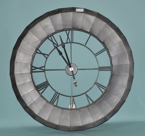 12: LARGE OXIDIZED METAL BATTERY OPERATED CLOCK