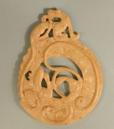 2: CARVED STONE DISC SHAPED ORNAMENT