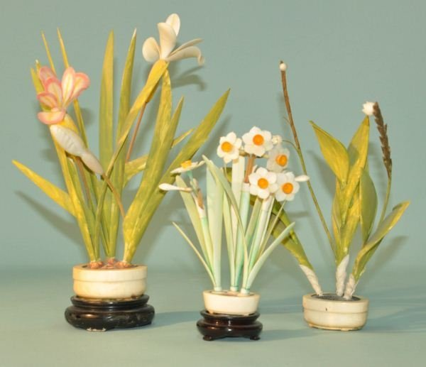 98: LOT OF THREE PAINTED IVORY FLOWERING PLANTS
