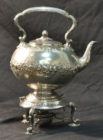 10: ANTIQUE SILVERPLATED TEAPOT  ON STAND