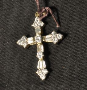 10C: A NEW STAMPED 14KT YELLOW GOLD DIAMOND CROSS