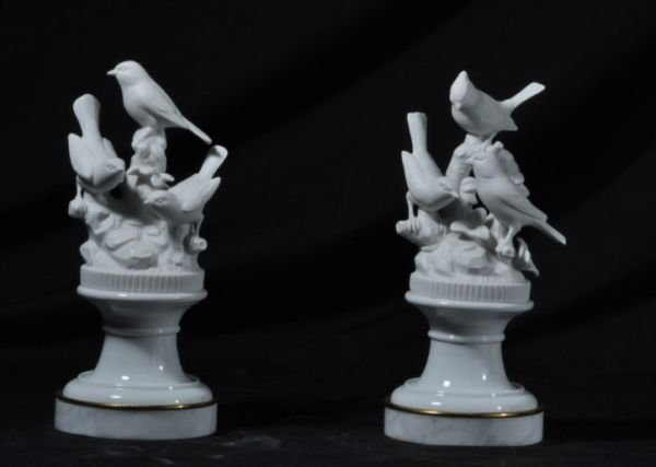 PAIR OF PORCELAIN BIRD SCULPTURES ON MARBLE BASES