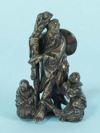 CARVED SOAPSTONE FISHERMAN WITH CHILDREN