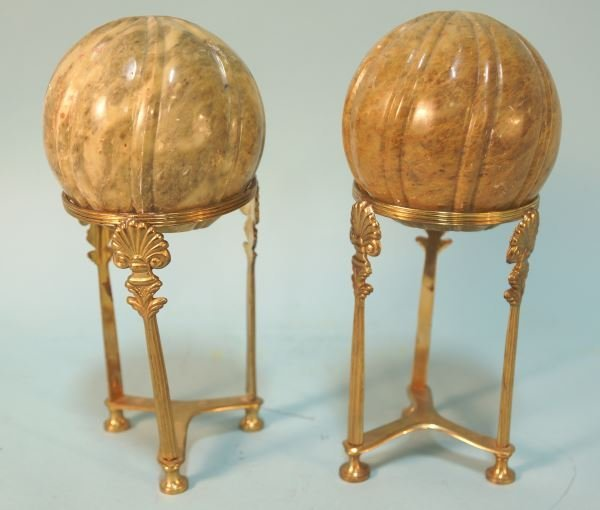 PAIR OF CARVED MARBLE SPHERES ON STANDS