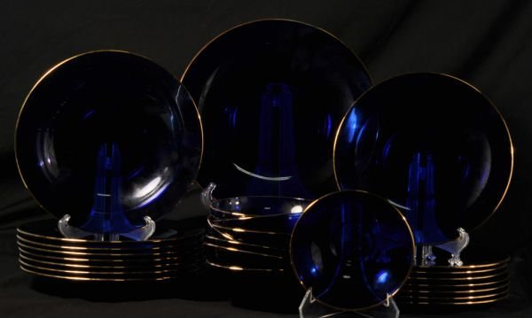 THIRTY-TWO BLUE GLASS PLATES